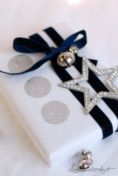 Frost | JFM Christmas Inspiration 2015 | Black & white Christmas wrap with touches of silver |
