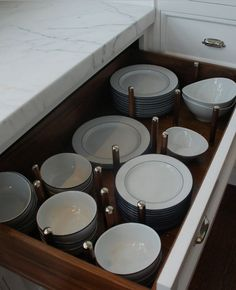 Great Idea: Place dishes in pot and pan drawers instead of upper cabinets for easier access.