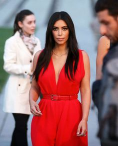 Kim Kardashian in a red jumpsuit at the Armenian Genocide Memorial in Yerevan