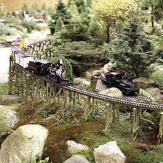 A Railroad Garden: Engineering Togetherness  About 400 feet of track, seven engines, and 30 railroad cars create a family favorite railroad garden in this pretty backyard.