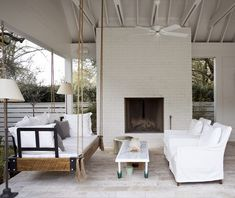 Ceiling fans, outdoor fireplace and a hanging daybed in this great outdoor area at a home in South Carolina by architect, Heather A. House Design, Hanging Beds, House, Home, Indoor, Porch Swing, Outdoor Spaces, Outdoor Living, Farmhouse Style