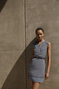 Add a skinny belt to Ann Taylor's Foulard Border Print dress to define your waist.