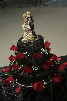 Cake and Topper idea for a Halloween Wedding. (We actually used a statue from that same series as a topper for our Halloween wedding).