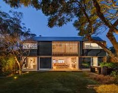 This Australian home has a palette of recycled brick, brass, internal timber lining boards, solid timber, and rough sawn tactile cladding reminiscent of shou sugi ban (burnt wood siding). Modern Wooden House, Modern House Design, Timber Architecture, Architecture Design, Contemporary Barn, Modern Barn, Recycled Brick, Hip Roof, Roof Structure