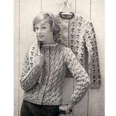 Misses Cable Cardigan Sweater Knitting Pattern Embroidered.   An attractive piece, long sleeved, seven button front closure, striped color band at the neck and ribbing at the bottom and sleeve ends.  And, oh ... did I forget to mention the cables.   Wonderful rows of cables.  And, if you'd like to take the cables up an additional notch, you can also embroider a small flower in each of the cables, changing the look entirely.