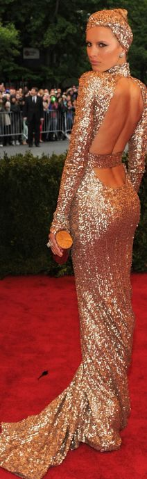 Karolina Kurkova - 2012 Met Gala. The supermodel attended the event with Rachel Zoe, who designed this custom long sleeve rose gold sequinned gown with open back and train.