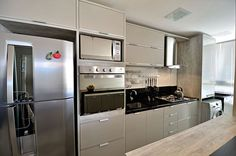 Once found only in the rear of the house, today's kitchen design takes the kitchen out the background. The challenge for kitchen design is in creat… Modern Kitchen Cabinets, Kitchen Furniture, Kitchen Decor, Kitchen Appliances, Interior Design Kitchen, Kitchen Storage, Home Kitchens, Kitchen Remodel, Sweet Home