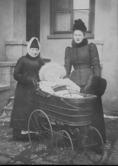 Mary Riddle (nee Whishaw) with her first child and nurse in the rear courtyard of the English Church, 56 English Embankment. Mary's husband was Curate at the church