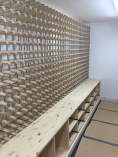 Bespoke traditional wine racking in natural pine and case racks feature as well as a nice handy surface area. All of the wine racking throughout was supplied by Wineware in the UK.