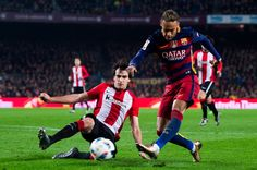 Neymar Santos Jr (R) of FC Barcelona makes a pass with the opposition of Inigo Lekue of Athletic Club during the Copa del Rey Quarter Final Second Leg between FC Barcelona and Athletic Club at Camp Nou stadium on January 27, 2016 in Barcelona