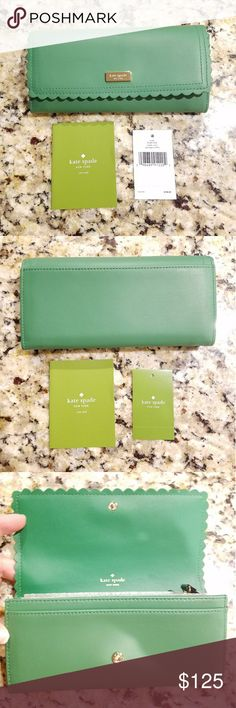 """Kate Spade Cyndy Sprout Green Wallet Hello Gorgeous! Kate Spade Cyndy Wallet Sprout Green Scalloped Wallet Genuine Leather Scalloped front Wallet has a zip pocket inside. 16 card slots. 2 separate larger pockets and one bill pocket. 1 extra slip pocket on the outside back Retail price $168 Measures 7.5"""" x 4"""" Woven lining 14k gold logo emblem on the front. NO TRADES! REASONABLE OFFERS CONSIDERED! kate spade Bags Wallets"""