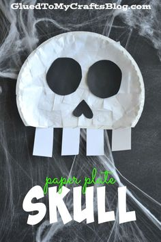 Paper Plate Skull. Use paper plates, paper, and glue to make spooky skeleton crafts with your kids for Halloween.