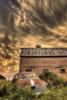 Storm Clouds at the Barn with an Antique Car - Saskatchewan, Canada Abandoned Buildings, Old Buildings, Abandoned Places, Abandoned Cars, Abandoned Mansions, Scary Places, Sky And Clouds, Storm Clouds, Old Farm
