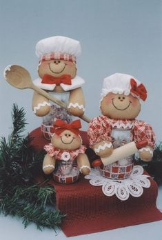 """Gingersnaps Gingerbread family with  10"""" couple & 5"""" baby They'll be cute in the kitchen! Easy jar painting. . . just sponge on checkerboard then squirt on squiggles  http://www.krafdee.com/home1.html."""