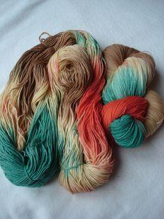 Alpaka-Wolle in beige/braun/rot/grün