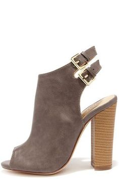 """You have every reason to flaunt the Bootie-licious Dark Taupe Peep Toe Booties, and their adorable day-to-night look! Crinkly vegan leather constructs a peep-toe upper with a cutaway heel, and two adjustable ankle straps with gold buckles. 4.25"""" wood-look block heel adds a nice contrast in tan. Cushioned insole. Rubber sole has nonskid markings. Available in whole and half sizes. Measurements are for a size 6. All vegan friendly, man made materials."""