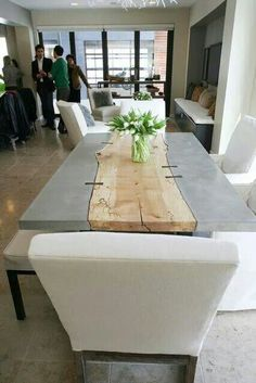 Interesting idea putting wood and concrete together to make a table.