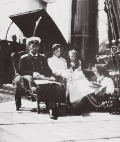 Tsar Nicholas II, Empress Alexandra and their daughters Marie and Tatiana