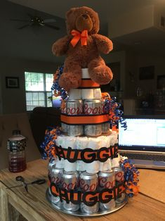 Super easy diaper and beer cake for the Dad to be. Used about 80 size 1 diapers, each rolled. This includes diapers to fill in between the beer cans.  Dad is a Bears fan, hence the bear and colors but could be modified to fit your needs. :)