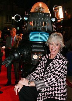 "-This Nov.8,2006, file photo supplied by Warner Home Video shows actress Anne Francis posing with Robby the Robot at a screening to commemorate the 50th anniversary of the film, ""Forbidden Planet,"" in Los Angeles. Francis, who was the love interest in the 1950s science-fiction classic ""Forbidden Planet"" and later was sexy private eye Honey West"" on TV, died on January 3, 2011. She was 80."