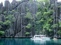 The Calamian Islands in the Philippine province of Palawan include Coron Island is known for having the cleanest inland body of water in the Philippines, called Kayangan Lake. Calauit Island is known for hosting a number of endangered African animal species. Some of the finest beaches, islands and tourist spots in the Philippines are found in this island group.