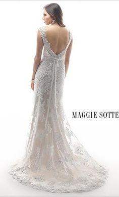 Maggie Sottero Lark (4MS870): buy this dress for a fraction of the salon price on PreOwnedWeddingDresses.com