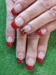 Red tips with christmas candy cane freehand nail art