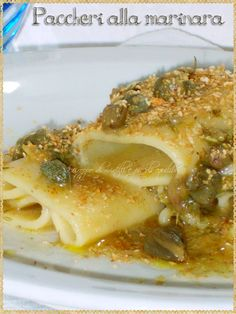 Paccheri alla marinara (Pasta with wild fennel, anchovies, capers, lemon and breadcrumbs)