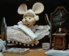 "Topo Gigio on the Ed Sullivan Show.  I used to go to bed right after this.  He said ""Kiss me good-night Eddie"".  Look how adorable his little bedroom is with the crocheted bedspread and the tiny candle."