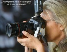 """""""The camera makes you forget you're there.  It's not like you are hiding but you forget, you are just looking so much.""""  -Annie Leibovitz #quote"""