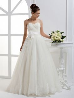 Pretty A-line dropped waist satin wedding dress. I love the top part of this dress!
