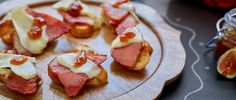 Client | These ham and brie crostini bites are an elegant, but simple way to use leftover spiral sliced ham at an after the holidays gathering!