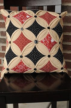 Cathedral windows pillow with buttons.