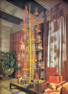 """An ultra-Modern Christmas tree of candle holders and starbursts was shot for the December 1961 issue of """"House Beautiful."""" (From Mid-Century Christmas, reprinted with permission of Hearst Communications, Inc. Retro Christmas Tree, Alternative Christmas Tree, Christmas Time Is Here, Christmas Past, Christmas Candles, Modern Christmas, Christmas Design, Christmas Holidays, Antique Christmas"""