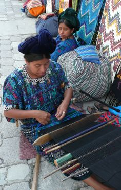 This photo shows a weaver on the back-strap loom in Santa Catarina Palopo, Guatemala. Mayan women have been weaving and wearing their traditional huipiles (traditional Mayan woman's blouse) and cortes (hand-woven skirts) for centuries. In the weaving are symbols of the Earth's sacredness and their culture's unique vision of the universe. By supporting Mayan women weavers, we provide them with much needed income that allows them some economic self-sufficiency. http://coloresdelpueblo.org/