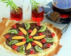 Pizza de chocolate con fruta fresca