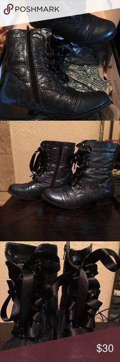 Iron Fist Combat Boots Shimmery teal colored size 10 combat boots with skulls on them and ribbon shoe strings. In fantastic shape!! Iron Fist Shoes Lace Up Boots