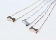 Dog bone charm pendant necklace in matte gold by zizibejewelry, $12.00