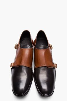 ALEXANDER MCQUEEN // Tan Leather Bi-Color Monks Low top leather monk shoes in black. Round toe. Contrast tan panels at heel and face. Tonal leather double strap flap and pin buckle closures. Tonal stitching. Leather upper, leather sole. Made in Italy. $745 CAD