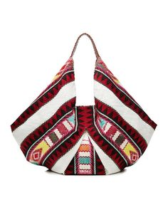 This Embroidered Fabric Tote by Christophe Sauvat will have you beach ready in no time.