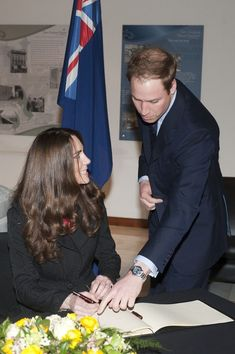 Kate Middleton Photos - Prince William and Harry at New Zealand House - Zimbio. Kate Middleton is listening to the instructions.