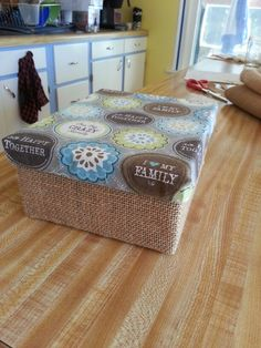 Shoe box + burlap + cute fabric + spray adhesive = super cheap decorative storage box
