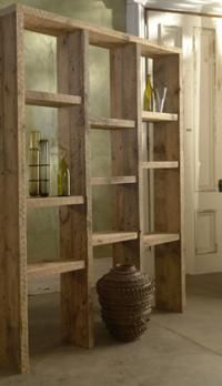 Their Granary Shelving Unit features antique pine from the interior of these granary bins. The natural erosion of the pine over the past century has formed the unique undulation seen on the face of each piece.
