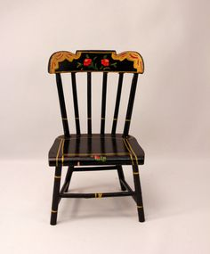 Pennsylvania Dutch Chair. Pennsylvania Dutch Period 1680-1850. No specific designer. Black w/ turned legs, back is made with vertical rails and horizontal slats. Painted motifs.