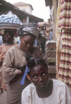 Hair threading in Lagos, Nigeria. 1974. Bruno...