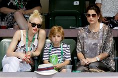 Singer Gwen Stefani eats a treat from her son Zuma Rossdale as they sit with Mirka Federer, wife of Roger Federer of Switzerland, in a stadium suite during the quarter-final match between Federer and Juan Martin Del Potro of Argentina at the Indian Wells ATP tennis tournament in Indian Wells, California, March 16, 2012