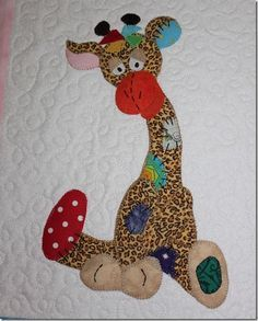 cute appliqued quilt giraffe but why not use giraffe print?