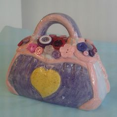 Ceramic handbag painted at Craft & Clay and finished with coordinating buttons.
