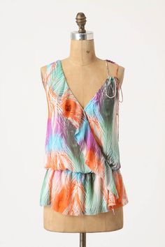 It's the blouse version of the dress I like. Not sure how it'd look on, but I like the feminine lines and bright colors.