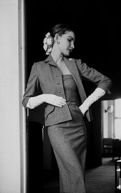 Photo by Gjon Mili 1951 Model is wearing a slim strapless flannel dress and a matching tailored jacket. (design by Mollie Parnis.)